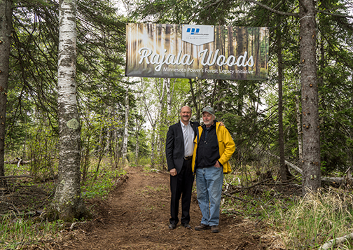 Al Hodnik, ALLETE chairman, president and CEO, and Jack Rajala in the woods near Taconite Harbor. The site on the North Shore of Lake Superior is the first to be highlighted in Minnesota Power's Rajala Woods initiative.