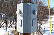 Meter enclosures on power pole