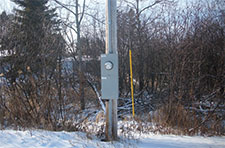 Meter enclosure on power pole